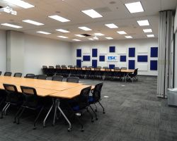 This large conference room can be divided in two with an operable partition. It also features sound-capturing fabric.