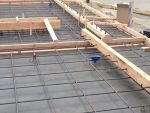 The rebar and pickup and brace points are being wired into the framing of the two concrete tilt-up panels.