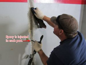 Epoxy is injected into each port. It fills the crack the entire thickness of the tilt-up, concrete panel.